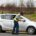 """Swellendam, South Africa - February 8, 2012: Traffic officer stops a vehicle at the side of the road and is doing vehicle check with the driver"""